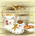 Background with teapot, sweets and cup of tea on a grunge wooden Stock Image