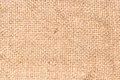 Background texture of a coarse woven fabric or textile with natural fibre and weave pattern detail in a neutral beige colour Stock Photography