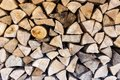 Background texture of split logs in a woodpile Royalty Free Stock Photo