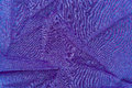 The background texture of fabric draped purple lycra Royalty Free Stock Photography