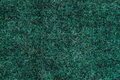 Background a texture a knitted woolen fabric of dark green color Royalty Free Stock Photo