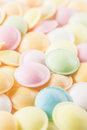 Background texture made of many round candies close up vertical in colorful pink orange yellow and green tones Stock Images