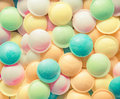 Background texture made of many round candies in colorful pink orange yellow and green tones Stock Images