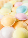 Background texture made of many round candies macro vertical in colorful pink orange yellow and green tones Royalty Free Stock Image