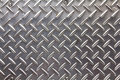 Background texture of metal diamond plate. Royalty Free Stock Photo