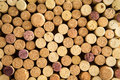 Background texture of neatly arranged corks from wine and champagne bottles packed tightly together with their tops facing up to Royalty Free Stock Images
