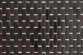 Background texture and pattern of a dark wood mat or bamboo with white cross weave detail repeat parallel close up Stock Images