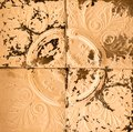 Background texture rusted vintage tin ceiling tile with carvings