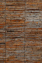 Background texture of a rustic bamboo screen or ceiling with weathered dried parallel canes in full frame view Royalty Free Stock Photos