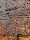 Background texture of some natural stone granite. multi-colored - red, gray. Royalty Free Stock Photo
