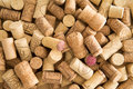 Background texture of used wine corks a randomly scattered pile assorted with cultivar and winery details on the surface the Royalty Free Stock Images