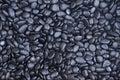 Background texture of waterworn black pebbles Royalty Free Stock Photo