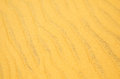 Background or texture wavy yellow beach sand Stock Photos