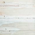 Background texture of white wooden boards painted or whitewashed with a mottled brushstroke pattern in square format with Stock Photography