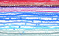 Background of threads with blue, pink, white and silver beads Royalty Free Stock Photo