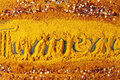 A background of turmeric powder with Turmeric text