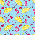 Background of umbrellas, rubber boots, handbags and eyewear. Spring and autumn shoes and accessories. Fashion Royalty Free Stock Photo