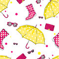Background of umbrellas, rubber boots, handbags and eyewear. Spring and autumn shoes and accessories. Royalty Free Stock Photo