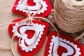 Background Valentine day with red hearts, bows and skeins Royalty Free Stock Photo