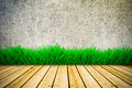 Background with vintage wall and green grass Stock Photos
