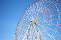 Background of white ferris wheel in blue sky Royalty Free Stock Images