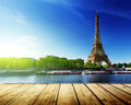 Background with wooden deck table and eiffel tower in paris Stock Images