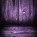 Background wooden panel boards violet from wall with a sheaf of light Royalty Free Stock Photo