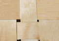 Background woven light beige cloth with wide birch bark strips intertwined eco