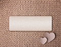 Background for your text hear of beige wool texture and two cardboard hearts Royalty Free Stock Photography