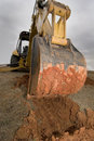 Backhoe digging in red dirt. Stock Images