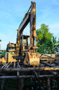 Backhoe and landslide protection is building near thr canal Royalty Free Stock Image