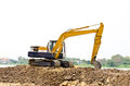 Backhoe machine excavation soil works outdoors construction site Stock Images