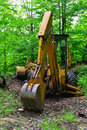 Backhoe parked in wilderness old cleaning the forest Stock Photography