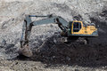 backhoe working In coal mines Royalty Free Stock Photo