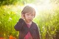 Backlight girl portrait in garden Royalty Free Stock Images