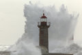 Backlit big stormy wave over old lighthouse Royalty Free Stock Photo