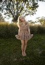Backlit Blond in Sun Dress Royalty Free Stock Photo