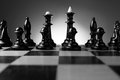 Backlit chess pieces on a chessboard low angle view of line of with pawns king queen and bishops Stock Photos