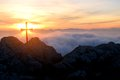 Backlit cross over the clouds Royalty Free Stock Photo