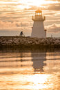 Backlit lighthouse in gaspe peninsula new richmond quebec canada Stock Photo