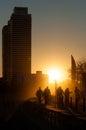 Backlit people walking at Port Olimpic, Barcelona. Stock Photo