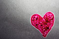 Backlit Pink Textured Heart on Gray Background Stock Images