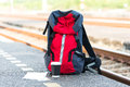 Backpack, map, cellphone and notebook on bench at train station. Royalty Free Stock Photo