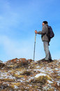 Backpacker and blue sky Royalty Free Stock Photo
