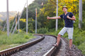 Backpacker catching Train on Countryside Railroad