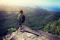 Woman backpacker enjoy the view on mountain peak