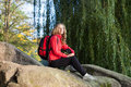 Backpacker enjoying relaxation on a halt in rocks Royalty Free Stock Photos