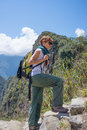 Backpacker exploring the steep Inca Trail of Machu Picchu, the most visited travel destination in Peru. Summer adventures in South