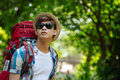 Backpacker in the forest portrait of sunglasses standing Royalty Free Stock Photography