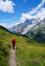 Backpacker hiking in the mountains on a tourist tr Royalty Free Stock Images